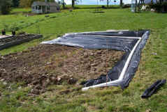 The topsoil pad with drain pipe in place