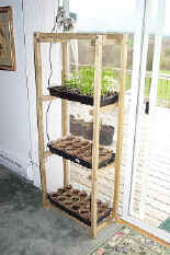 do it yourself seedling rack in sliding glass door.