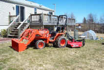 New Kubota B7610 with loader and bush hog. Click for larger view